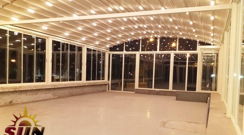Hotel Centrum Galati. Terasa amenajata cu pergola cu acoperis retractabil si sticla glisanta pentru laterale logo